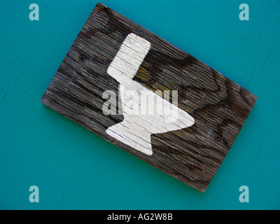 wooden sign for Toilet on a campingplace - Stock Photo