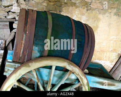 wooden barrel on an old cart wagon - Stock Photo