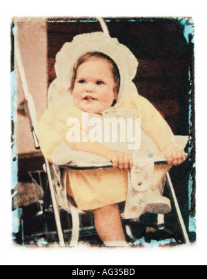 Polaroid transfer portrait of baby girl in stroller circa 1960s - Stock Photo