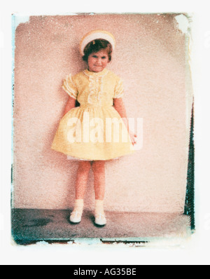Polaroid transfer image of young girl in Easter clothes circa 1960s - Stock Photo