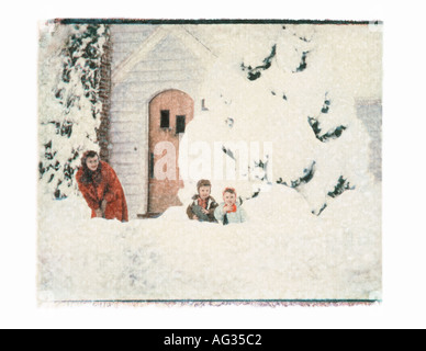 Polaroid transfer image of mother and children in snow bank circa 1950s - Stock Photo