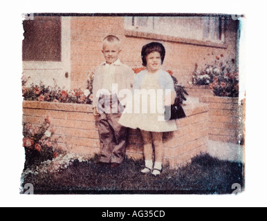 Polaroid transfer portrait of siblings in Easter clothes circa 1950s - Stock Photo