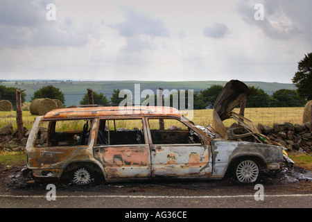Stolen Volvo Estate burnt out and dumped on side of road in South Wales UK - Stock Photo