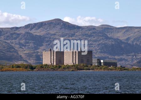 Trawsfynydd nuclear power station Gwynedd North Wales UK GB viewed over lake toward mountain range - Stock Photo