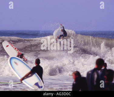 Surfer doing off the lip maneuver on big wave for annual Jesus Christian Classic Surf Contest Croyde Bay Devon England - Stock Photo
