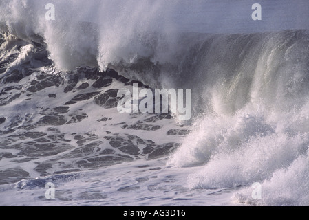 A classic powerful foaming white and grey big wave breaking and crashing over at Saunton Point Croyde Bay Devon - Stock Photo