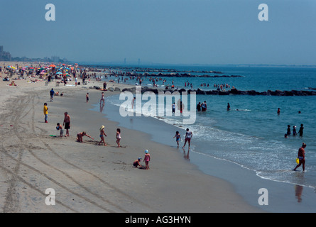 Coney island beach with bathers in the sea, seen from the Steeplechase pier, Coney Island, Brooklyn, New York City, - Stock Photo
