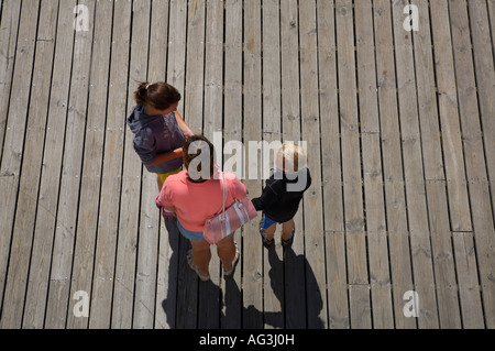 People standing on wooden dock taken from above - Stock Photo