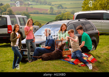 A FAMILY WITH TEENAGE CHILDREN ON A PICNIC UK - Stock Photo