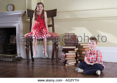 Boy and girl in room - Stock Photo