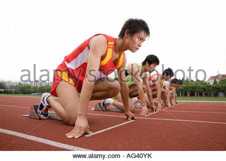 Runners on starting line - Stock Photo