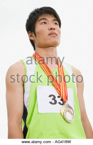 Athlete with medals - Stock Photo