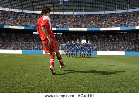 Footballer taking a free kick - Stock Photo