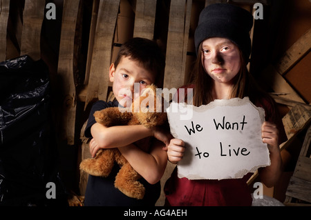 Impoverished boy and girl - Stock Photo