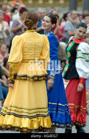 Female dancers of Orenburg State Russian Folk Choir in traditional dresses performing in Plaza Arriaga Bilbao - Stock Photo