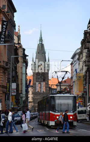 A tram on the busy main Street in Prague with the famous Jindrisska tower in the background - Stock Photo