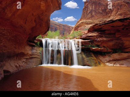 Waterfall in Coyote Gulch part of Grand Staircase Escalante National Monument in southern Utah canyon country  - Stock Photo