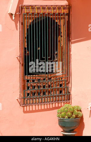 Morocco , Marrakesch , Jewish place of worship , Temple or Synagogue building with menora window motif & cactus - Stock Photo