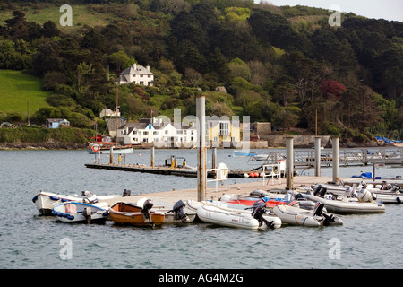 UK Devon rib boats moored at Salcombe jetty across from East Portlemouth - Stock Photo