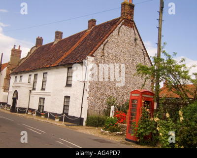 typical flintstone clad norfolk house in village of cley next the sea england - Stock Photo
