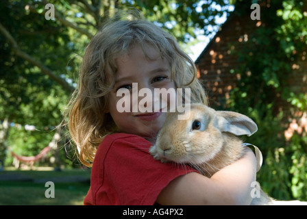 Five year old girl with pet rabbit Georgia Starkey model released - Stock Photo