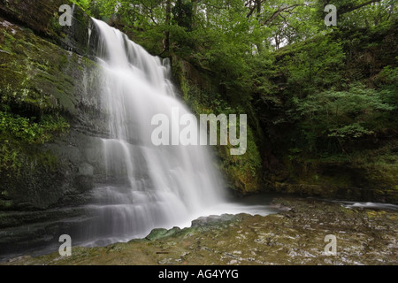 Wide angle view from the base of Sgwd Clun Gwyn waterfall in the Brecon Beacons National Park of Wales United Kingdom - Stock Photo