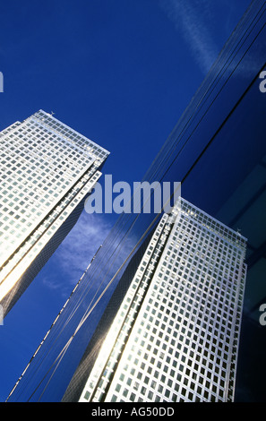 One Canada Square reflected in HSBC building, Canary Wharf London United Kingdom - Stock Photo