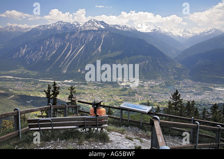 tourist viewing mountainous panorama - Stock Photo