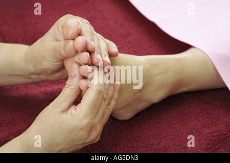 young woman getting a foot massage - Stock Photo