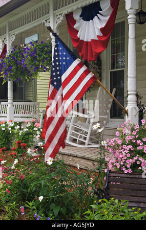 Patriotic Bunting On Porch Of Victorian Cottage With