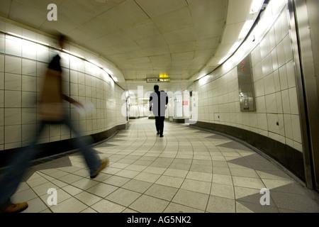 Underground walkway subway at Bank underground station with commuters - Stock Photo