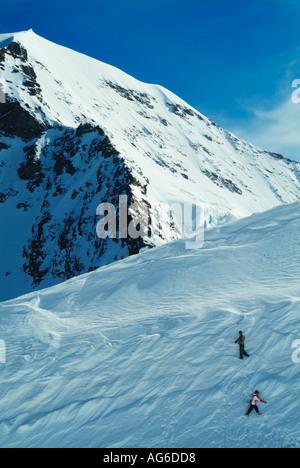 The Monch peak above Junfraujoch Bernese Oberland canton of Switzerland - Stock Photo