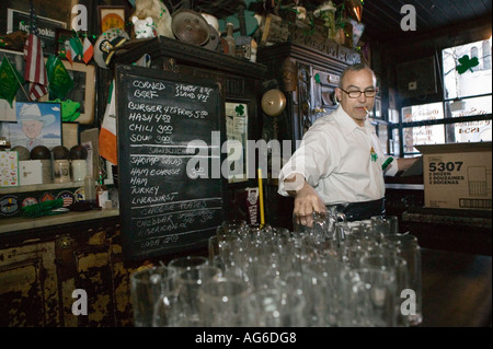 Staff get ready before the 8am opening on St Patrick s day at McSorley s pub in New York City USA March 2006 - Stock Photo