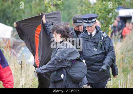 Protestors try to prevent police photographers from photographing protestors at the Climate Camp, Heathrow, UK - Stock Photo