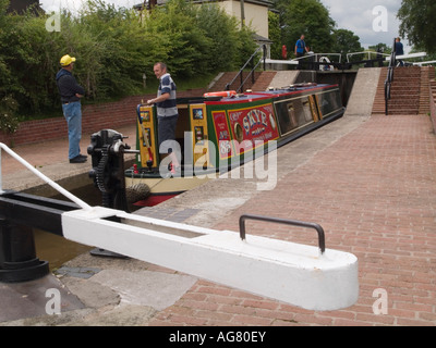 Narrowboat negotiating up three chamber staircase lock on Llangollen branch of Shropshire Union Canal Grindley Brook - Stock Photo