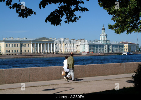 St Petersburg Russian Federation Couple Walk Along River Neva Academy of Sciences The Kunstkammer - Stock Photo