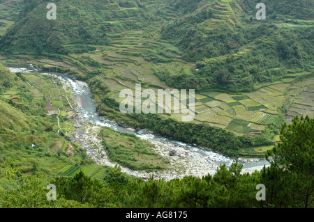 A river flows down a mountainside in the Cordillera Mountain Range in Northern Philippines - Stock Photo