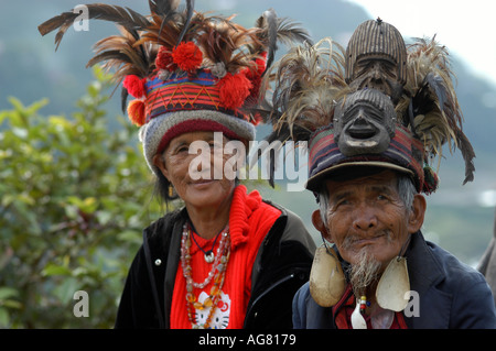 An old Ifugao couple pose in front of centuries old rice terraces in Northern Philippines - Stock Photo