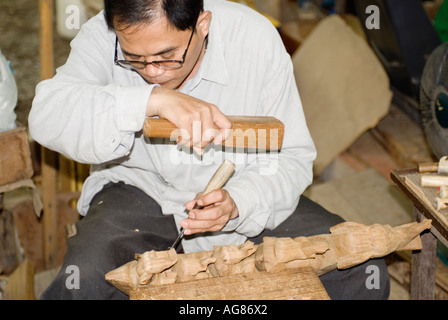 Thailand Thai Craftsman Sculpting  Wood Sculpture - Stock Photo