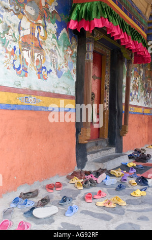Shoes in front of a buddhist temple, Ladakh, Jammu and Kashmir, India - Stock Photo
