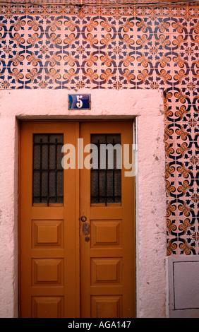 Azulejos glazed ceramic tiles in Alfama Lisbon Portugal - Stock Photo