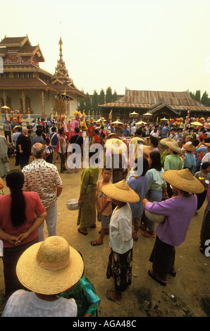 People gathering in the temple Wat Hua Wiang at Poy Sang Long the yearly ordination of novice monks Mae Hong Son - Stock Photo
