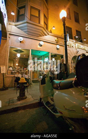 Vespa scooter parked in front of Caffe Vittoria and fire hydrant on Hanover Street in the Italian District north - Stock Photo