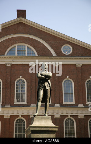 Samuel Adams Statue with Faneuil Hall in background Boston MA - Stock Photo