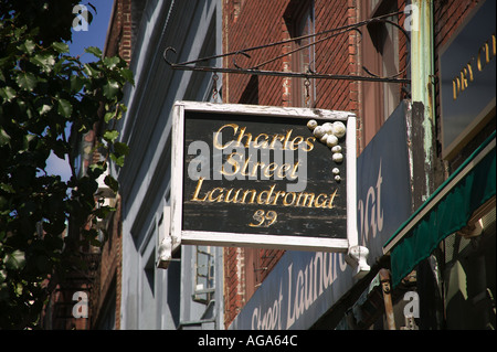 Unique signs on Beacon Hill graphically show type of business Laundramat Boston MA - Stock Photo