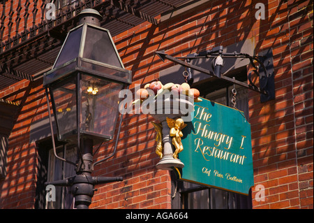 Unique signs on Beacon Hill graphically show type of business a Restaurant Boston MA - Stock Photo