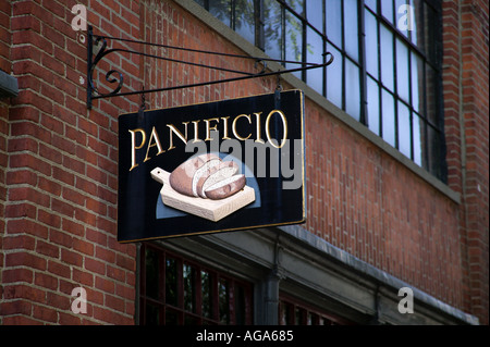 Unique signs on Beacon Hill graphically show type of business a Bakery Boston MA - Stock Photo