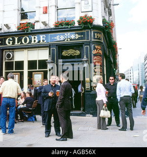 People drinking outside Globe Pub Moorgate London England - Stock Photo
