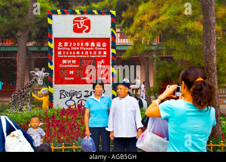 Beijing CHINA, Beijing Zoo Chinese Woman Photographing Her Family in front of  Sign at Entrance - Stock Photo