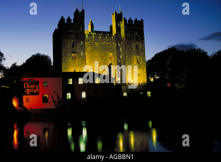 Early evening shot of Bunratty Castle and the hisotric pub Durty Nelly s in Ireland - Stock Photo
